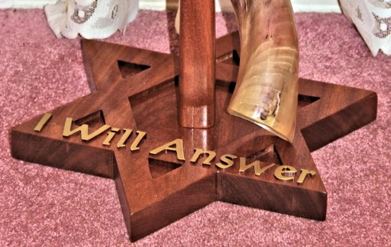 Hand crafted mahogany stand for Yemenite shofar. Custom outset letters Yeshua